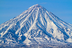 View of the Kronotsky Volcano. Kronotsky reserve. Early spring. Kamchatka Peninsula, Russia