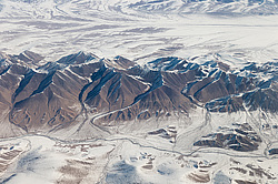View from the plane on the border of the Taklamakan Desert