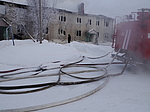 Putting out a fire in a wooden house. January 30, 2014, Usinsk, Komi